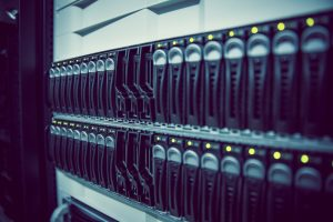Black rack mounted server tower in large data center for business broadband from Claritel